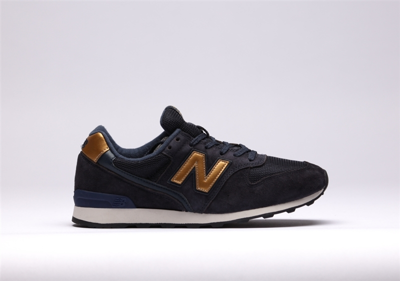 new balance donkerblauw goud dames